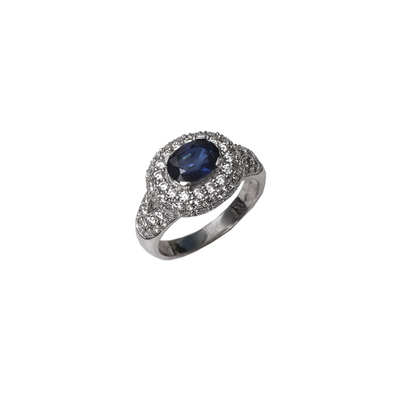 Witgouden ring met blauwe saffier en diamanten