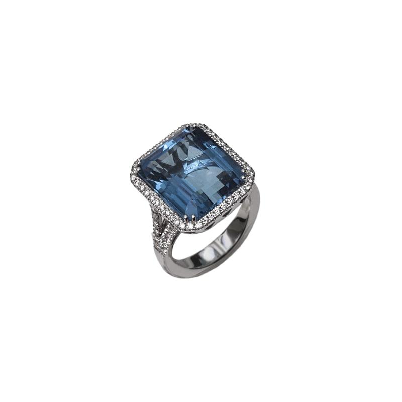 Bague en or blanc avec topaze bleu et diamants